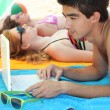 Stock Photo: Geek at beach