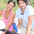 Stock Photo: Couple cycling together