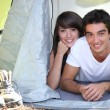 Teenage couple in a tent — Stock Photo