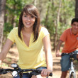 Young riding bikes — Stock Photo