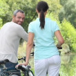 Couple riding bikes — Stock Photo