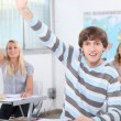 Three pupils in class with arms raised — Stock Photo