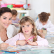 Three little girls in class — Stock Photo
