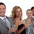 Couples drinking champagne - Stock Photo