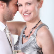 Man and woman in a clinch, dancing and drinking champagne — Stock Photo