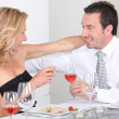 Stock Photo: Husband and wife enjoying romantic meal