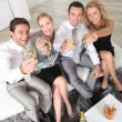 Young professionals holding champagne glasses — Stock Photo