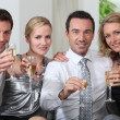 Colleagues drinking a glass of champagne — Stock Photo