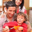 Parents and child preparing for Halloween — Stock Photo