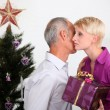 Father giving daughter Christmas present — Stock Photo