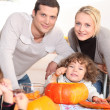 Stock Photo: Family carving pumpkins together