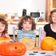 Three children with pumpkins — Stock Photo