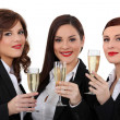 Three elegant women drinking champagne — Stock Photo