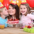 Mum and kids with birthday cake — Stock Photo