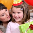 A woman celebrating her daughter's birthday. — Stock Photo