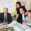 Family sitting in architect's office — Stock Photo #7712826