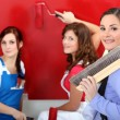 Royalty-Free Stock Photo: Three woman painting.
