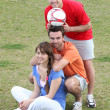 Friends taking a break from playing football — Stock Photo
