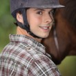 Stock Photo: Portrait of young horseback rider
