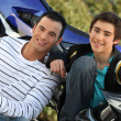 Portrait of father and teenage son — Stock Photo