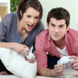 Couple of teenagers playing video games. — Stock Photo