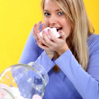 Woman eating candies — Stock Photo #7713228