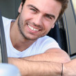 Young man sitting in the driving seat — Stock Photo