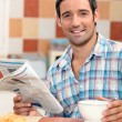 Mreading newspaper while having breakfast — Stock Photo #7713391