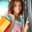 A woman with plenty of shopping bags. — Stock Photo