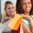 Girls with shopping bags — Stock Photo #7713474