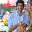 Stock Photo: Couple shopping at local market