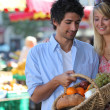 Couple shopping at the market — Stock Photo
