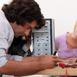 Stock Photo: Man repairing his computer.
