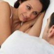 Couple talking in bed — Stock Photo