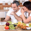 Stockfoto: Couple looking at a laptop during breakfast