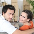 Stock Photo: Newlyweds moving in together