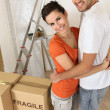 Couple with boxes marked fragile — ストック写真