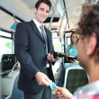 Smiling conductor checking tickets on a tram — Stock Photo