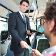 Smiling conductor checking tickets on tram — Stock Photo #7714318