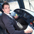 Young man driving tram — Stock Photo