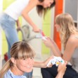 Three female roommates playing video game. — Stock Photo #7714409