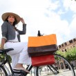 Low-angle shot of a woman on her bicycle - Stock Photo