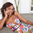 Afro American woman talking on her cell phone - Stock Photo