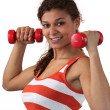 Young woman lifting dumbbells — Stock Photo