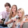Stock Photo: Three teenager playing musical instruments