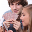 Stock Photo: Young playing cards