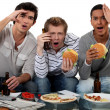 Group of friends watching a football game — Stock Photo