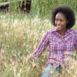Coloured girl in high grass - Stock Photo