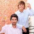 Young men in a wine bar - Stockfoto