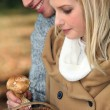 Stock Photo: Young couple gathering wild mushrooms